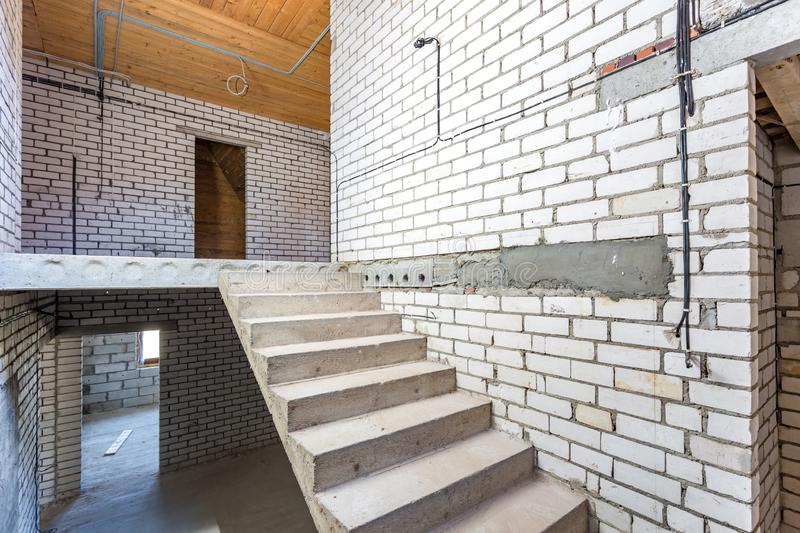 Empty interior in house without repair with white silicate brick walls.  royalty free stock photos