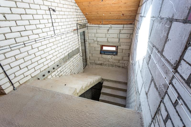 Empty interior in house without repair with white silicate brick walls.  royalty free stock images