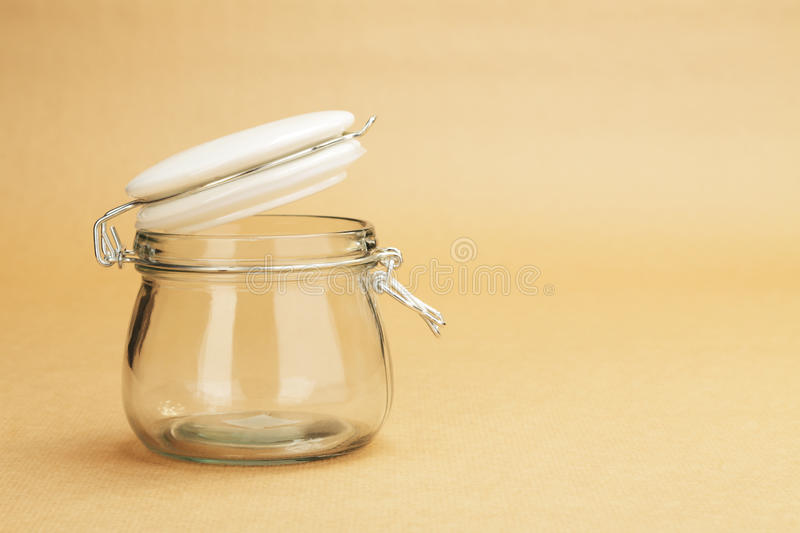 An empty jar with an open white lid royalty free stock photos