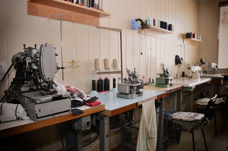 Empty jobs and equipment in the sewing workshop. general view. h. Orizontal format stock image