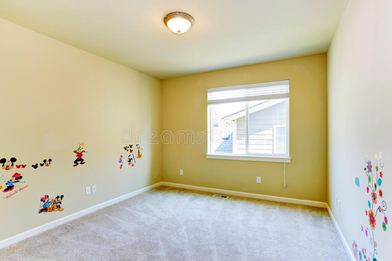 Empty kids room with painted walls stock images