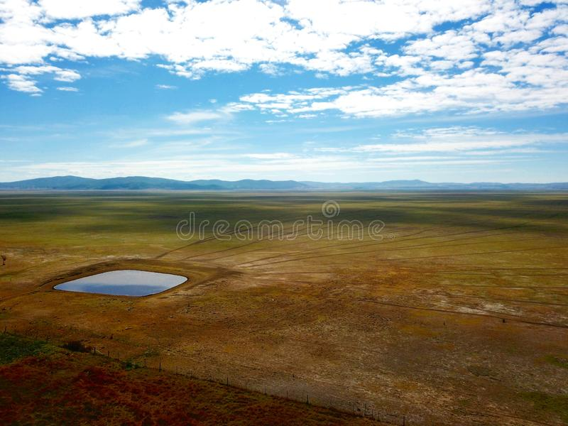 Empty Lake George nestled between a rural wind farm and farmland in Australia. Lake George is an endorheic lake, as it has no outflow of water to rivers and royalty free stock images
