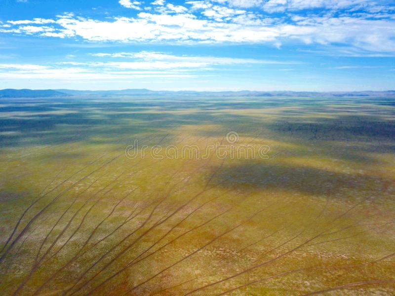 Empty Lake George nestled between a rural wind farm and farmland in Australia. Lake George is an endorheic lake, as it has no outflow of water to rivers and royalty free stock photo