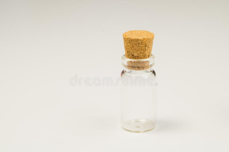 Empty little bottle with cork stopper isolated on white. transparent container. test tube. copy space. Empty little bottle with cork stopper isolated on white royalty free stock images