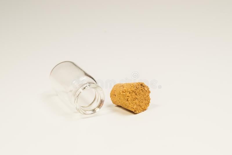 Empty little bottle with cork stopper isolated on white. transparent container. test tube. copy space. Empty little bottle with cork stopper isolated on white royalty free stock photo