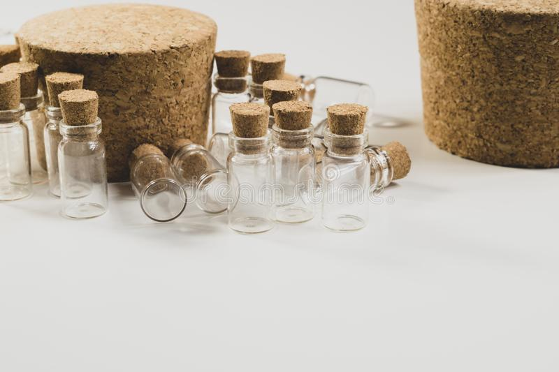 Empty little bottles with cork stopper isolated on white. transparent containers. test tubes. big cork. Empty little bottles with cork stopper isolated on white stock images