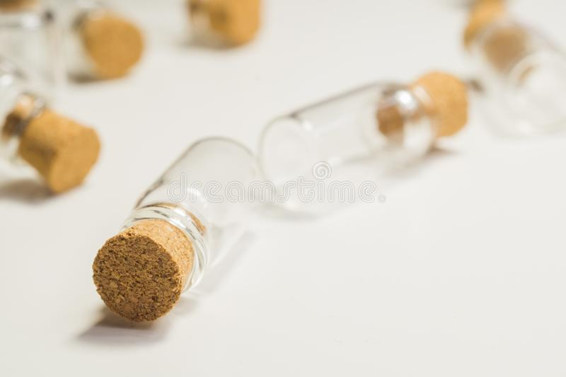 Empty little bottles with cork stopper isolated on white. transparent containers. test tubes. copy space. Empty little bottles with cork stopper isolated on royalty free stock images