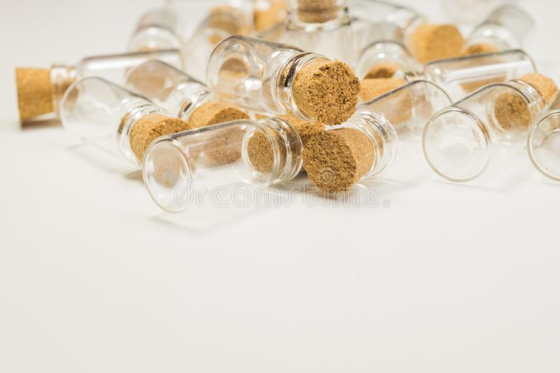 Empty little bottles with cork stopper isolated on white. transparent containers. test tubes. copy space. Empty little bottles with cork stopper isolated on stock photo