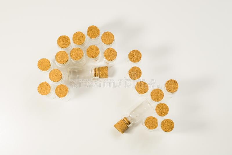 Empty little bottles with cork stopper isolated on white. transparent containers. test tubes. copy space. Empty little bottles with cork stopper isolated on stock photography