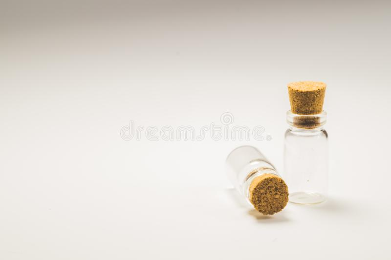 Empty little bottles with cork stopper isolated on white. transparent containers. test tubes. copy space. Empty little bottles with cork stopper isolated on royalty free stock photos