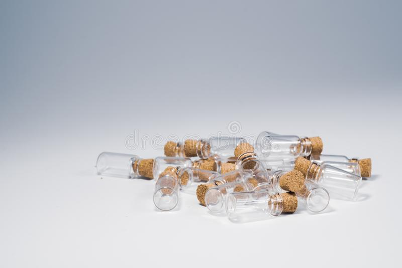 Empty little bottles with cork stopper isolated on white. glass vessels. transparent containers. test tubes. copy space. Empty little bottles with cork stopper royalty free stock photography