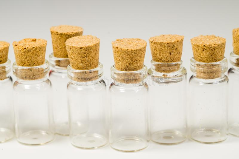 Empty little bottles with cork stopper isolated on white. transparent containers. test tubes. Empty little bottles with cork stopper isolated on white. glass stock photo