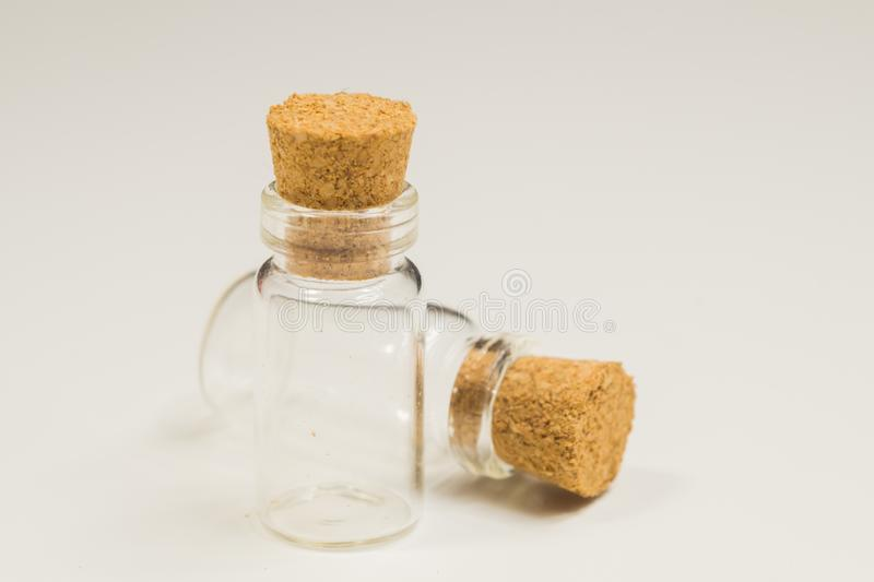 Empty little bottles with cork stopper isolated on white. transparent containers. test tubes. Empty little bottles with cork stopper isolated on white. glass stock images