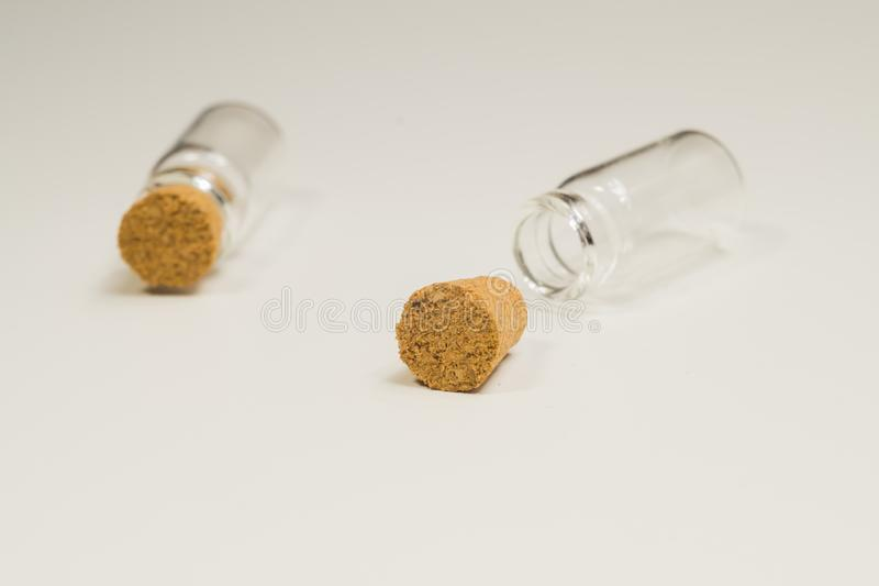 Empty little bottles with cork stopper isolated on white. transparent containers. test tubes. Empty little bottles with cork stopper isolated on white. glass royalty free stock photos