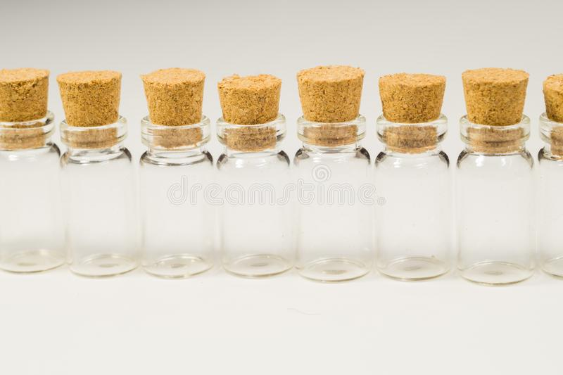 Empty little bottles with cork stopper isolated on white. transparent containers. test tubes. Empty little bottles with cork stopper isolated on white. glass stock image