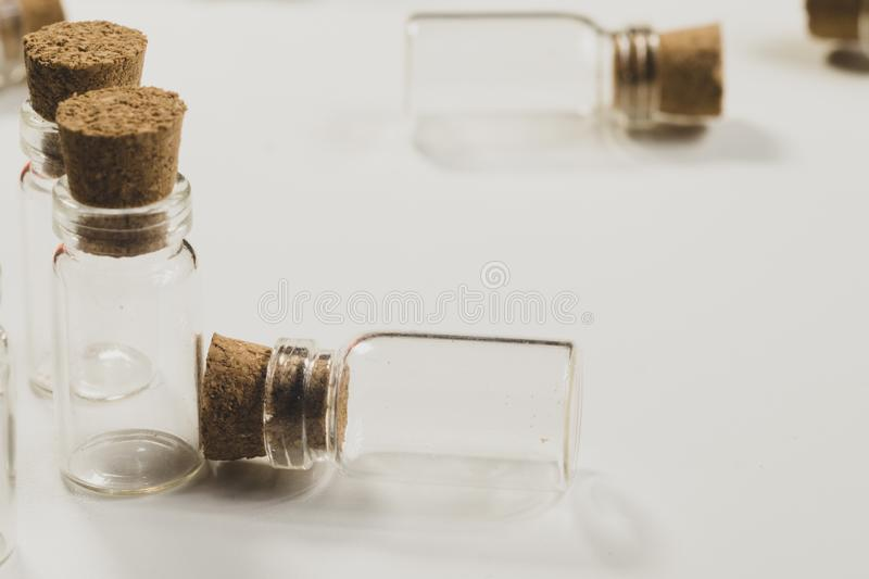 Empty little bottles with cork stopper isolated on white. glass vessels. transparent containers. test tubes royalty free stock images
