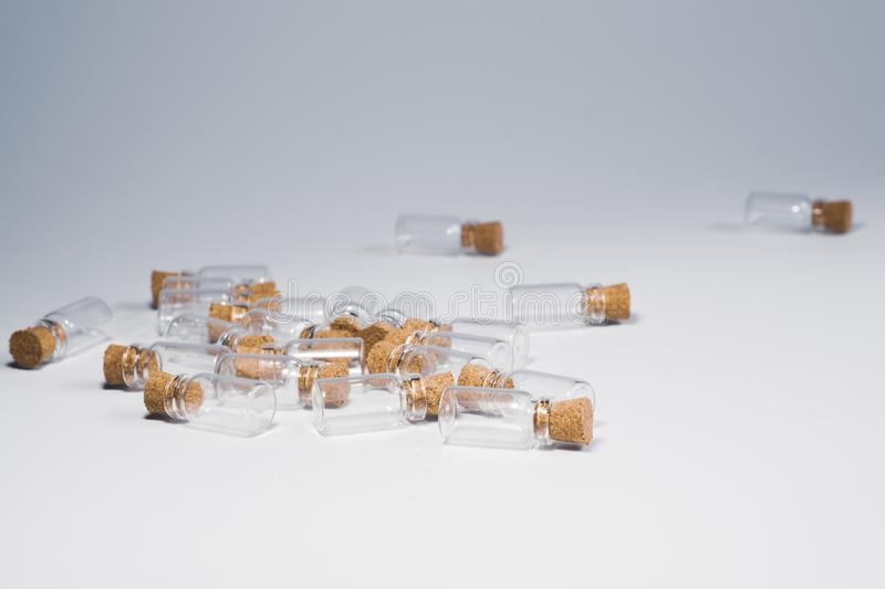 Empty little bottles with cork stopper isolated on white. glass vessels. transparent containers. test tubes. Empty little bottles with cork stopper isolated on stock images