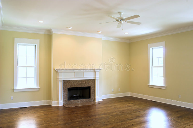 Empty living room with fireplace royalty free stock photography