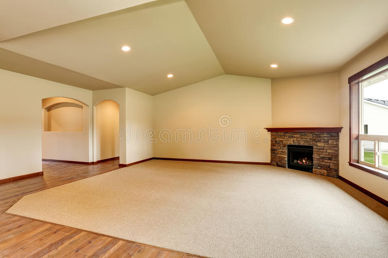 Empty living room with fireplace. Connected to kitchen area. royalty free stock photos