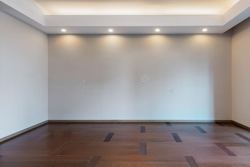 Empty living room in grey color. Illuminated and empty living room in grey color royalty free stock image