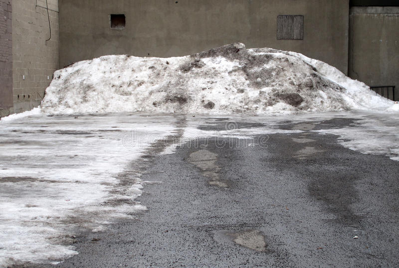 Empty lot with dirty snow pile. royalty free stock photos
