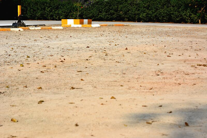 The empty lot parking on dirty gravel. Covered ground stock photos
