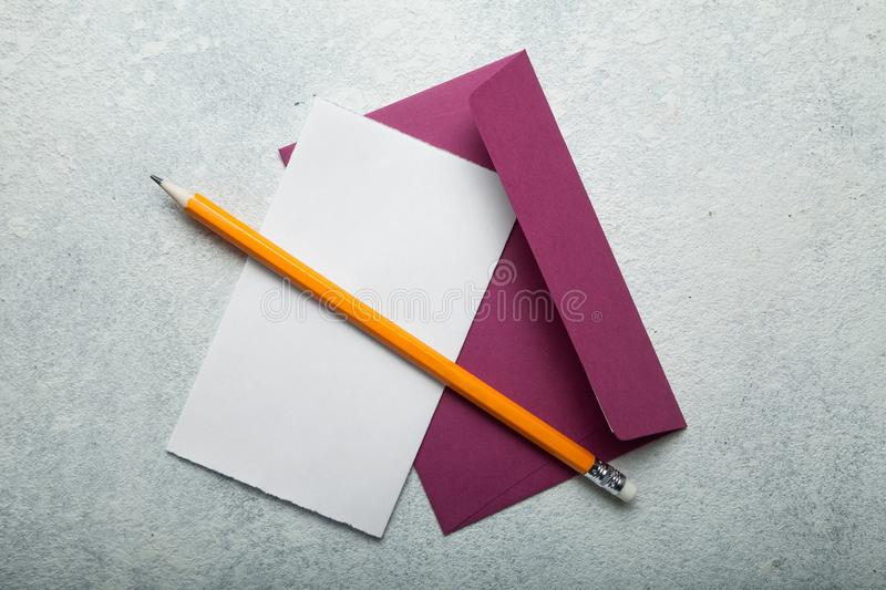 An empty love letter to Valentine`s Day. Paper, pink envelope and pencil on a white vintage desk, space for text stock photos