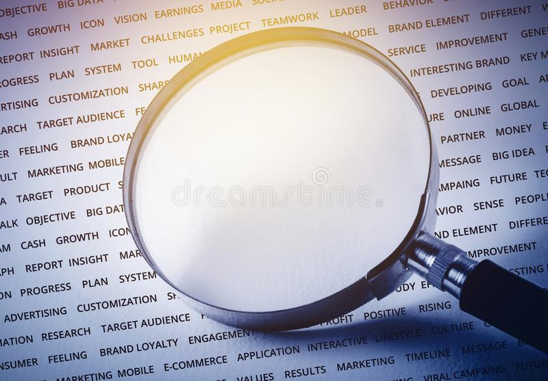 Empty of magnify on business strategy word. For marketing success concept / can you put some word royalty free stock images