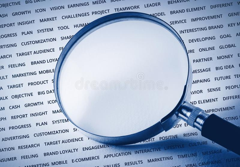 Empty of magnify on business strategy word. For marketing success concept / can you put some word royalty free stock image
