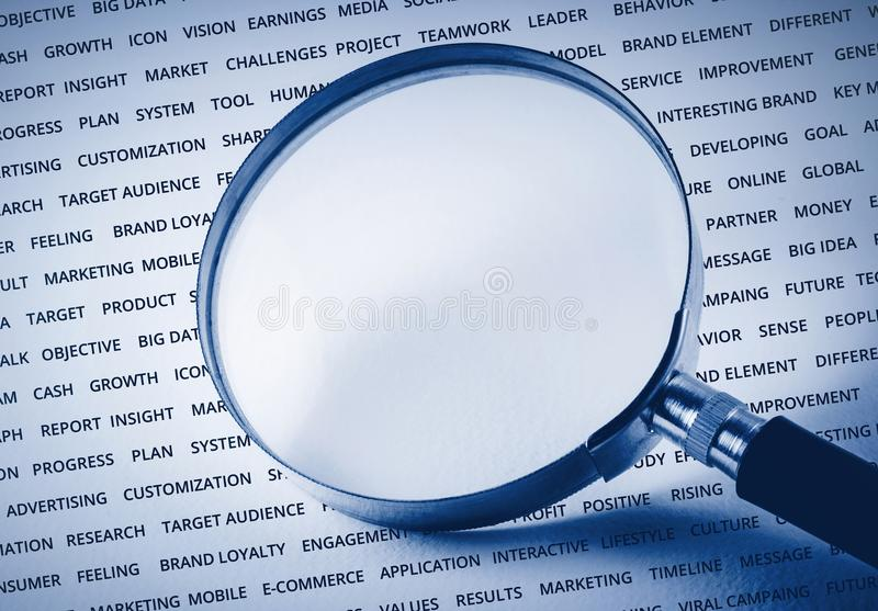 Empty of magnify on business strategy word.For marketing. Success concept / can you put some word stock image