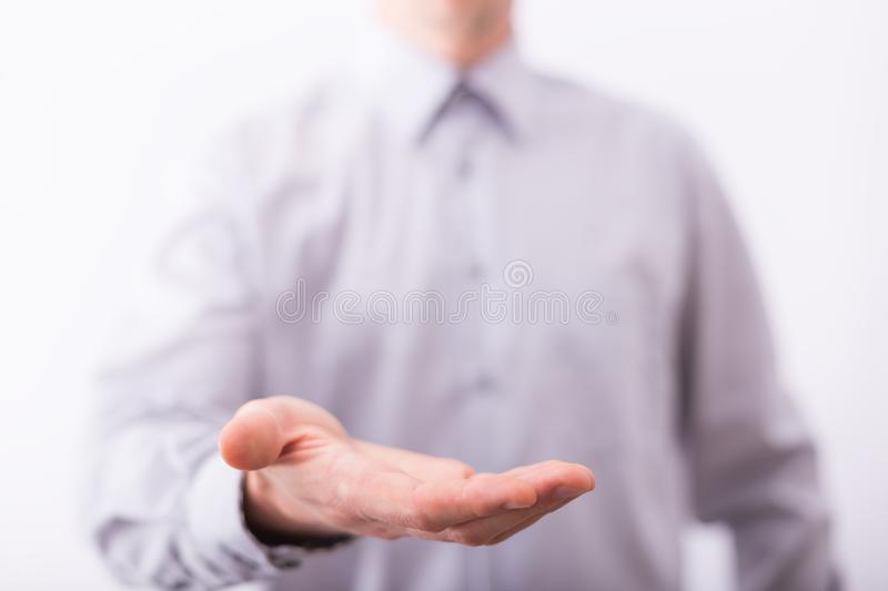 Empty male hand presenting or holding something royalty free stock photography