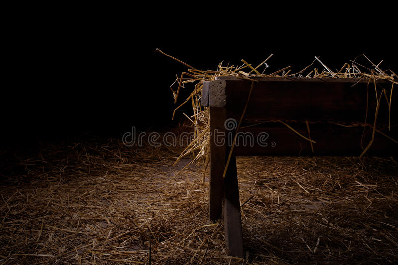Empty manger at night. Side view of an empty manger at night