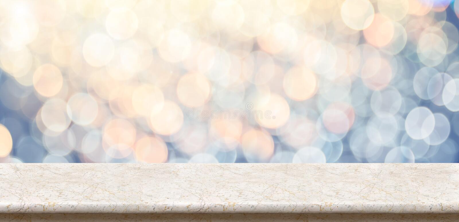 Empty marble glossy table top with blur sparkling soft pastel bl. Ue and orange bokeh abstract background,panoramic banner for display or montage of product royalty free stock photo