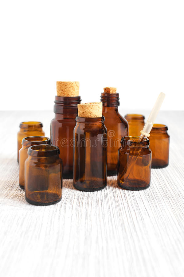 Empty medicine glass bottles and medicine dropper stock images