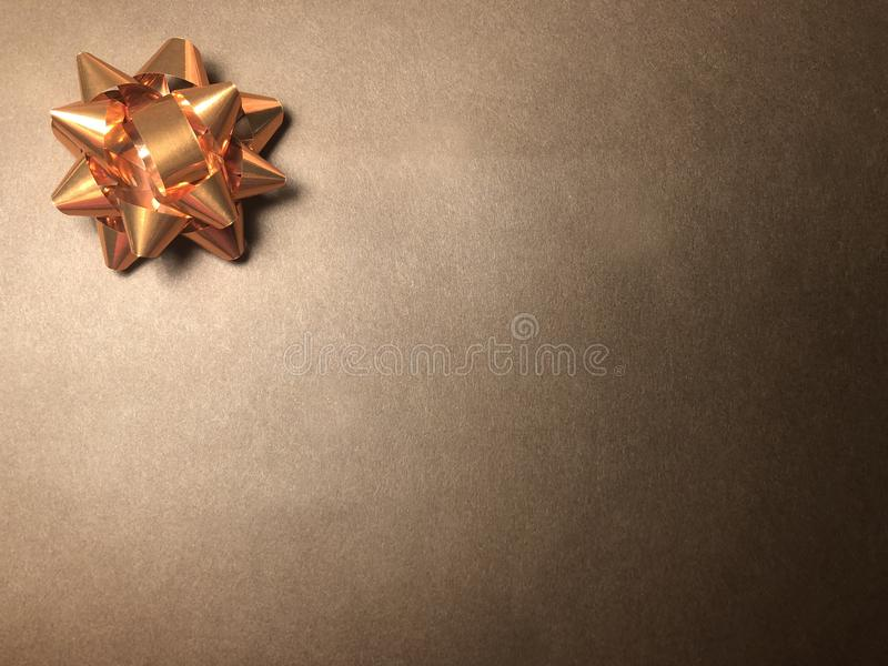Empty message area with ornament as bright star, note paper or frame on dark and light brown background. stock image