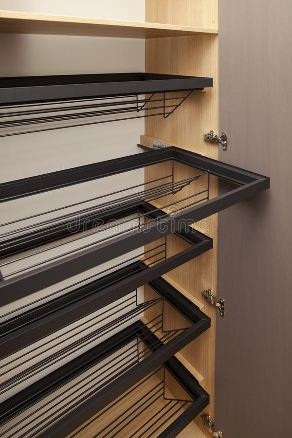 Empty metal shelves for shoes in the closet. Close up stock photos