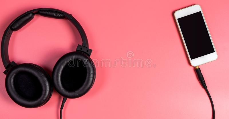 Empty mobile phone with headphone for Music concept. Empty mobile phone screen with headphone for Music concept stock images