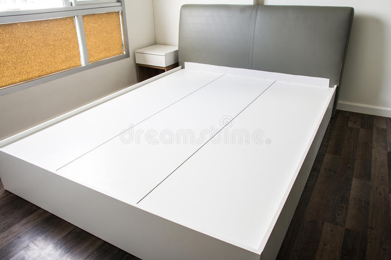 Empty modern bed stock photo