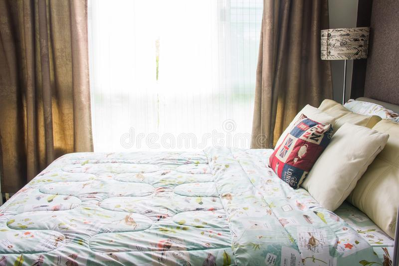 Empty modern bed in bedroom royalty free stock image