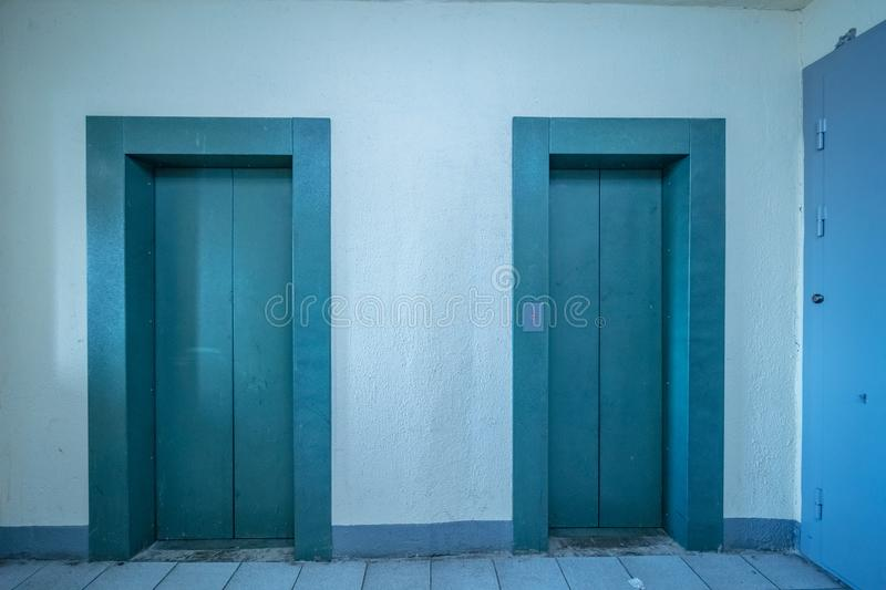 Modern elevator doors. Empty modern elevator or lift with closed metal doors royalty free stock images