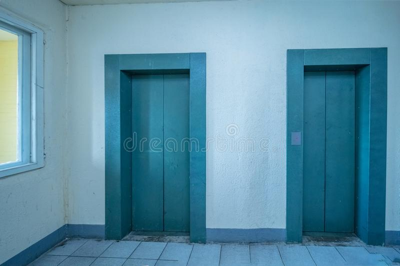 Modern elevator doors. Empty modern elevator or lift with closed metal doors royalty free stock photo