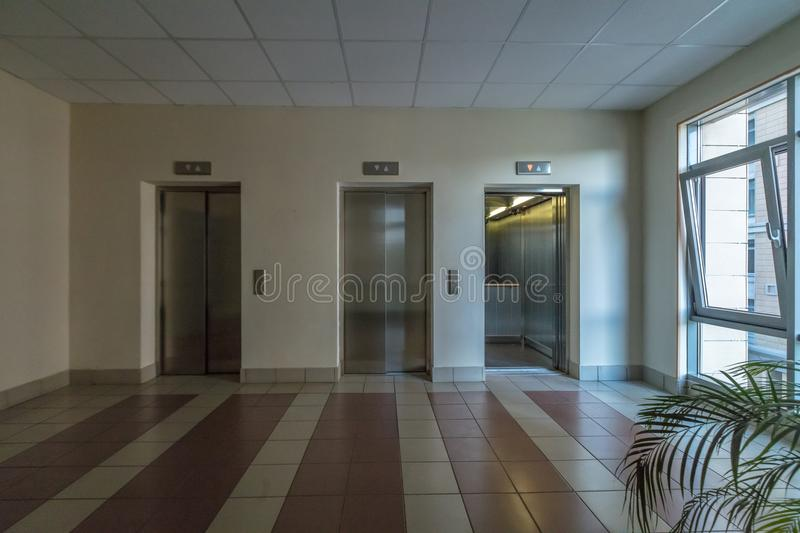 Modern elevator doors. Empty modern elevator or lift with closed metal doors stock images
