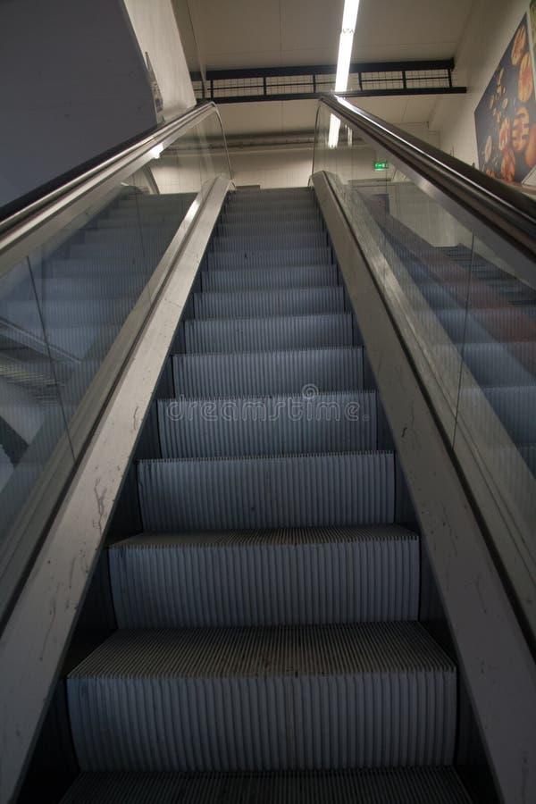 Empty modern escalator in interior of shopping center royalty free stock photos