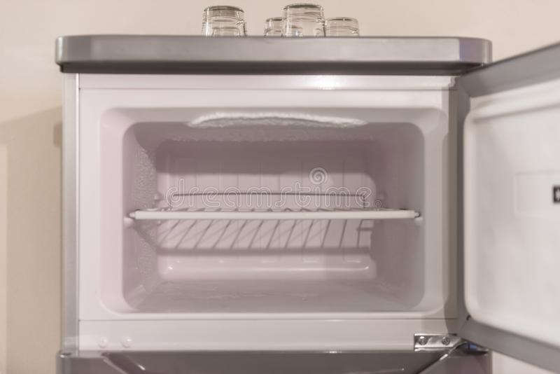 Empty modern fridge freezer. An empty model white fridge freezer with no food inside. Home refrigerator ready for use stock image