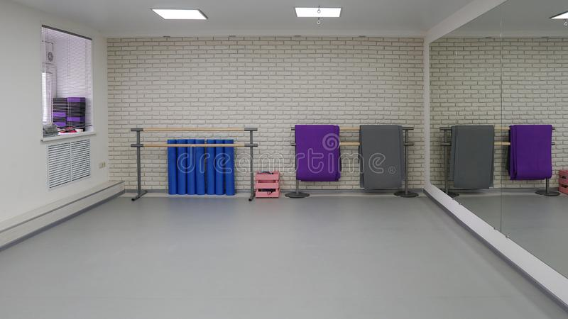 An empty modern hall for dance classes or fitness studio stock photography