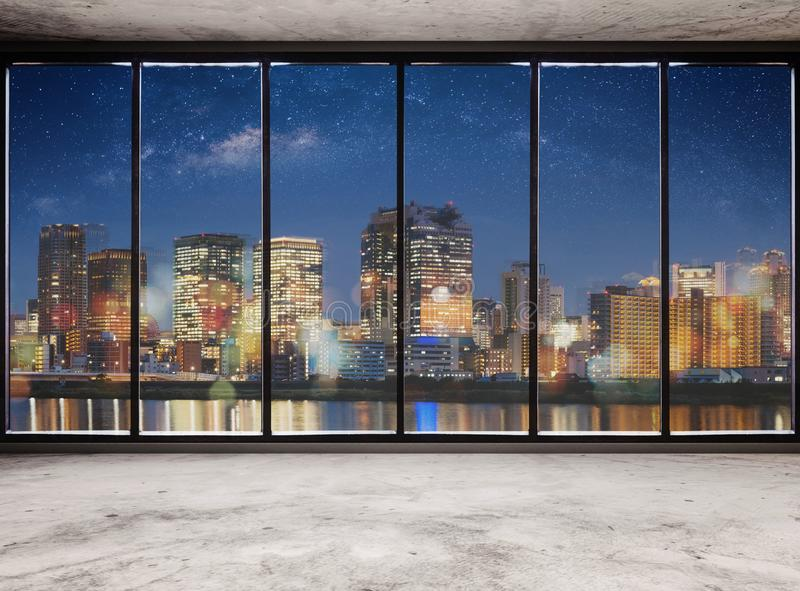 Empty modern interior space with city view at night and starry sky, Empty Business Office Interior royalty free stock image
