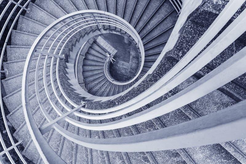 Spiral stairway. Empty modern spiral stairway, viewed from top stock photo