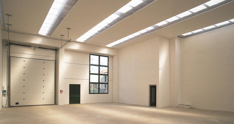 Empty modern warehouse royalty free stock photography