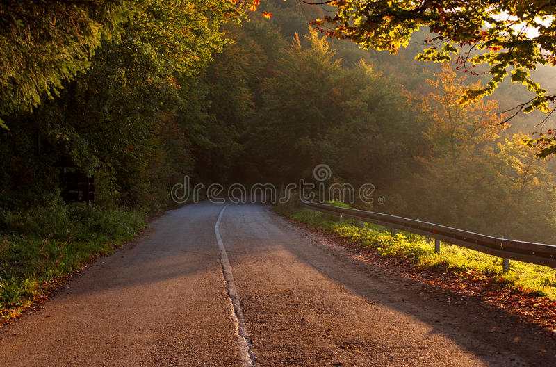 Empty mountain asphalt road. Beautiful autumn scene. stock image