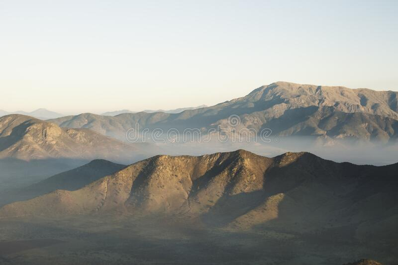 Empty Mountains Under Clear Blue Sky stock images